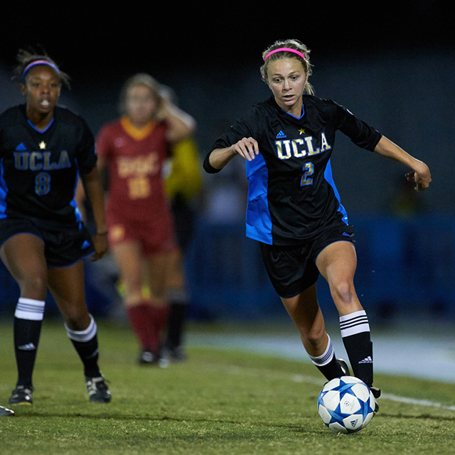 40f1b93c5fc ... action shot of female soccer players in UCLA and USC uniforms